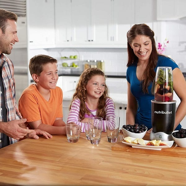 Happy family watching their NutriBullet Blender work