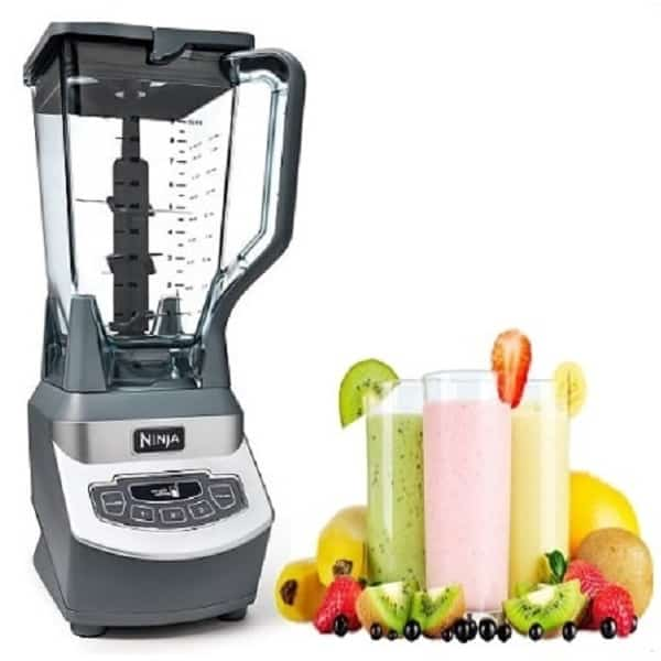 Three glasses fruit smoothie and a blender