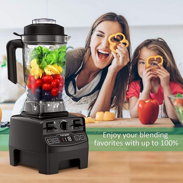 Mom and daughter having a good time using their best blender with their favorite fruit smoothie