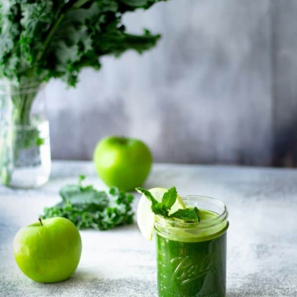Kale and green apples on the table